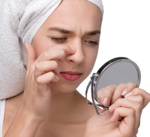 woman looking at blackheads