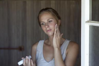 lady applying acne cream